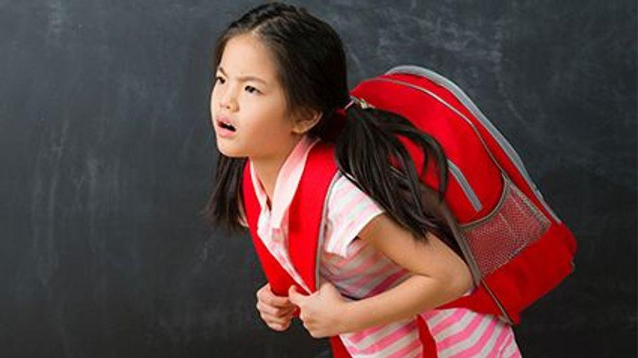 a girl with a heavy backpack
