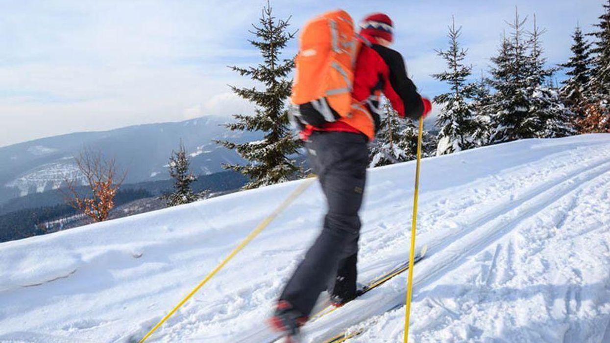 man ski walking in the winter outdoors