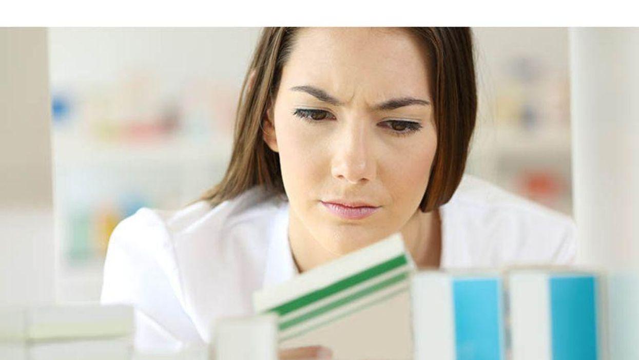 pharmacist looking at drug label