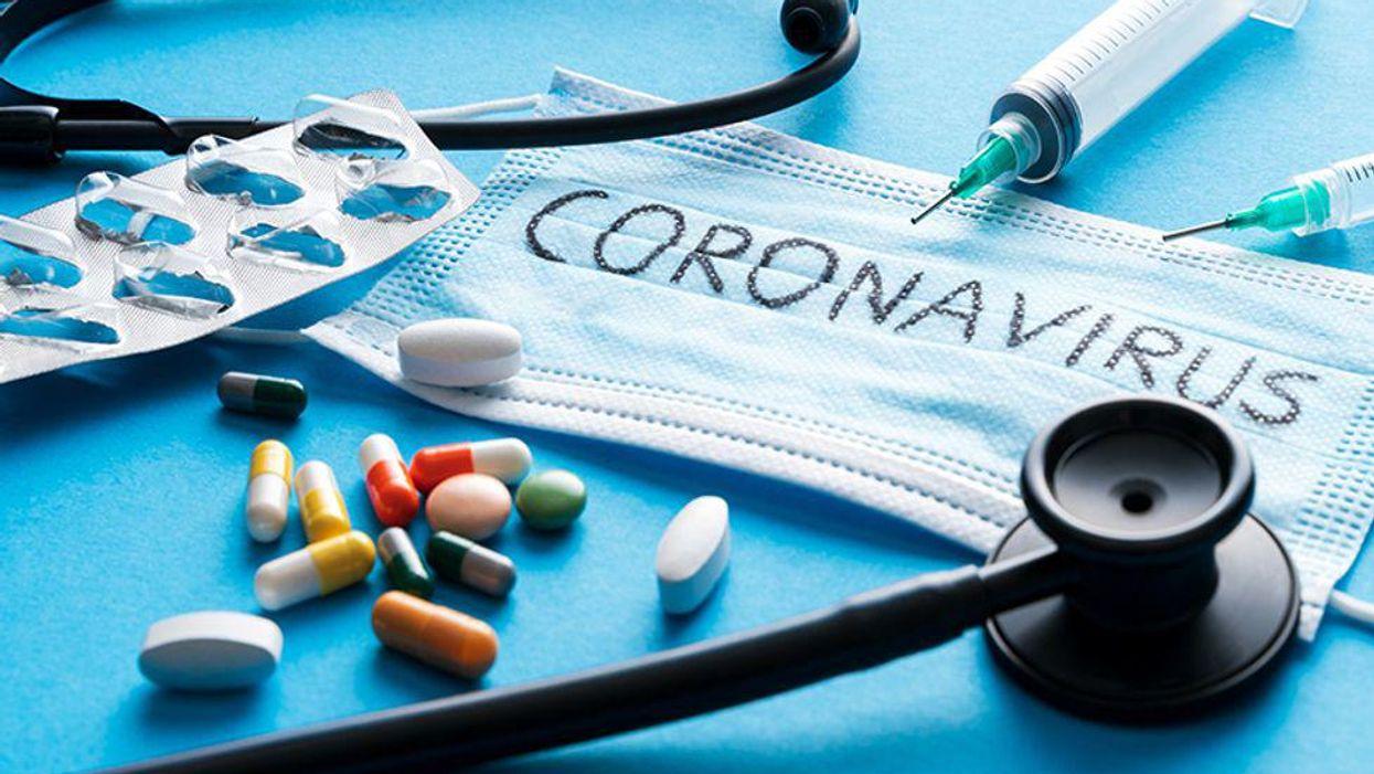 protective mask,pills, syringes, Stethoscope on blue background with coronavirus