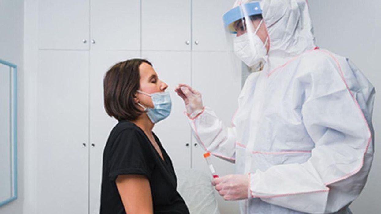 pregnant woman getting covid test