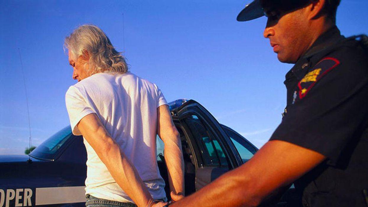 police officer arresting a driver