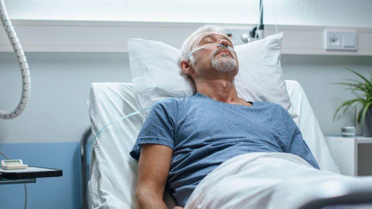 man patient hospital bed