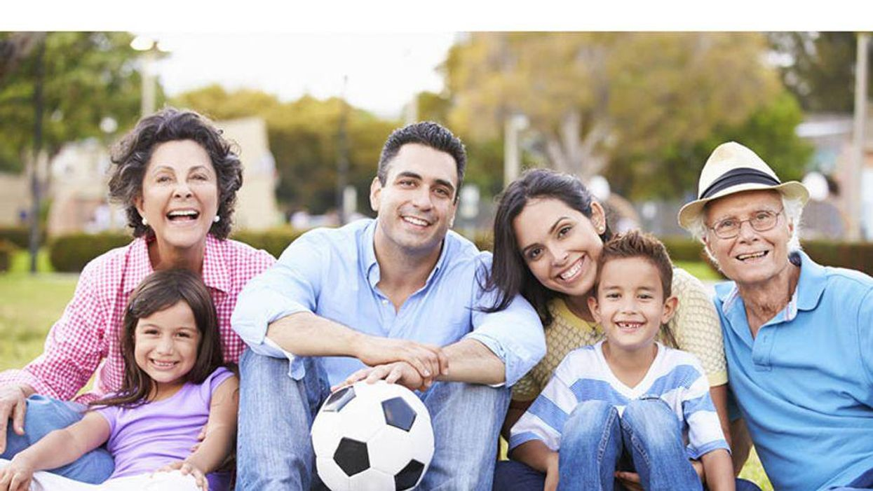 family with soccer ball outdoors