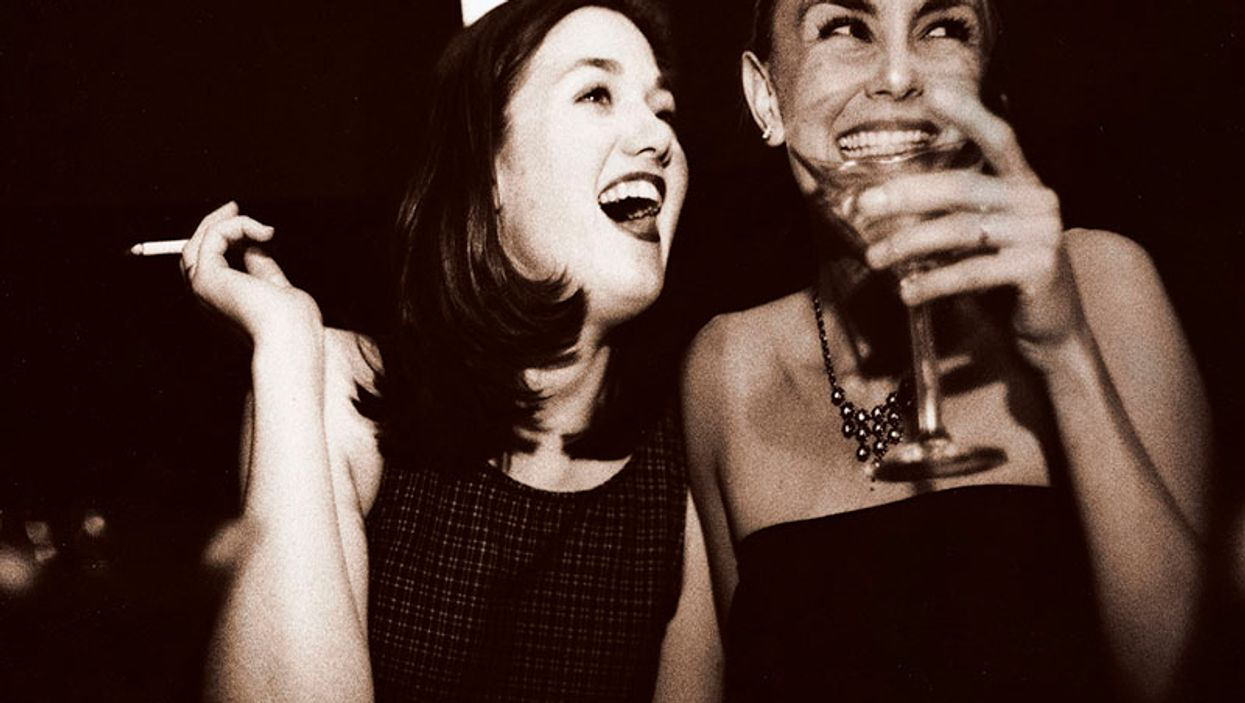 couple of women smoking and drinking