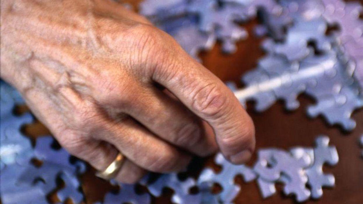 Elderly doing puzzle