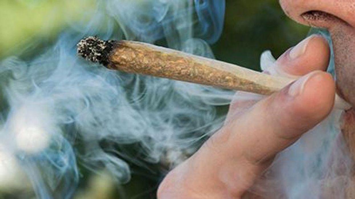 a person smoking marijuana