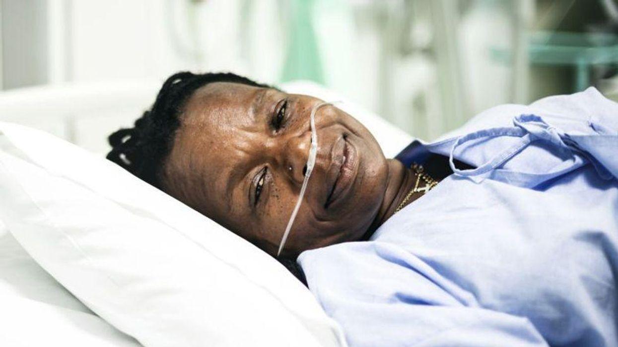 sick patient in hospital bed