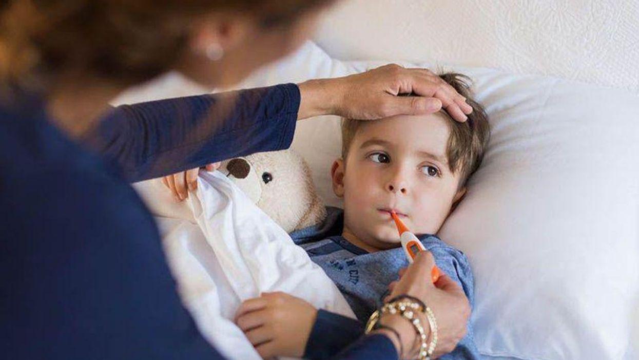 Child getting temperature taken