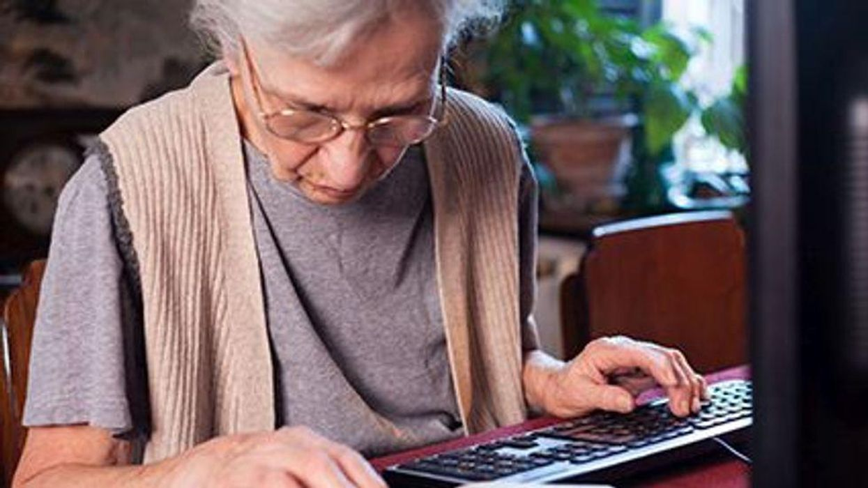 older woman sitting at the computer